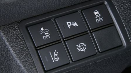 Close up of the buttons of the safety systems of the Honda Civic 5-door.