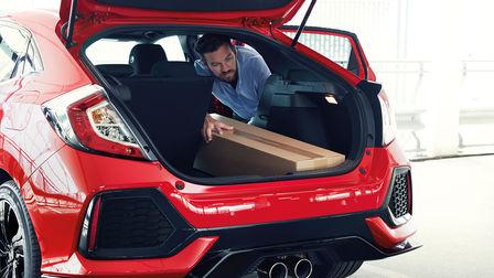 Three-quarters rear view Honda Civic - photo of trunk.