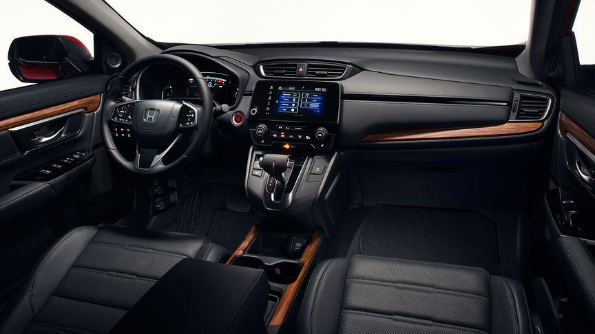 Zijaanzicht van het interieur van de Honda CR-V om de A-stijlen en bekleding te tonen.