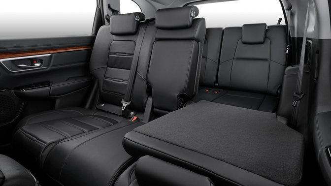 Zijaanzicht neerklapbare en extra zetels achteraan Honda CR-V.