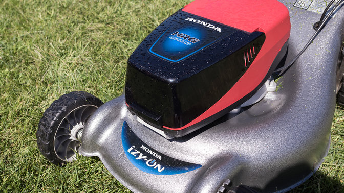 Close up of Honda izy-On lawnmower in garden location.