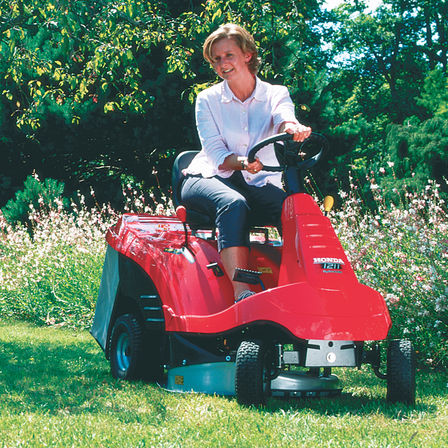 Ride-on, front three-quarter, being used by model, garden location.