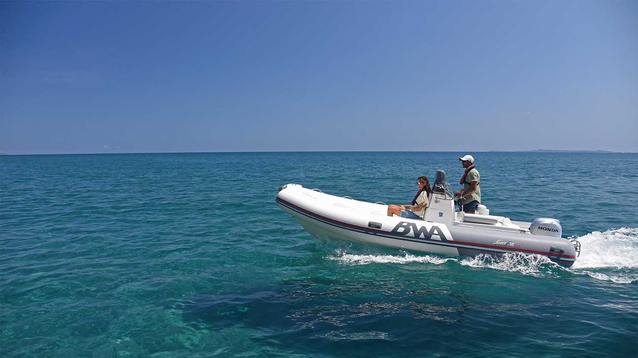 Couple riding an inflatable speed boat with a Honda BF 50 outboard engine